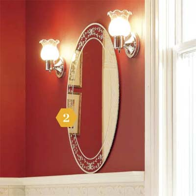 Hanging mirror on red wall