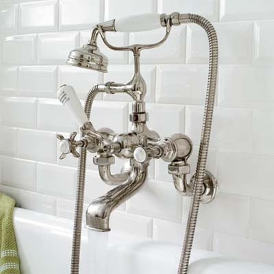 a wall mount tub filler for this classic twenties style remodeled bath