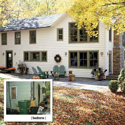 before and after views showing the new windows and bluestone patio at the back of this farmhouse remodel