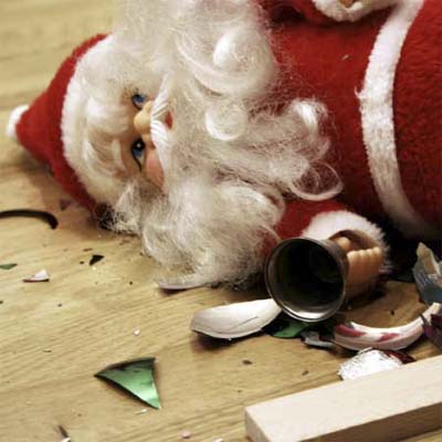 santa ornament lying on the floor amidst various broken ornaments