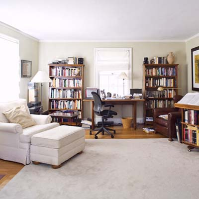 before view of the first-floor family room that doubles as a makeshift office for one of the homeowners