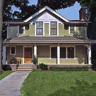 remodel in Minneapolis, MN with altered roofline, new paint job, energy-efficient windows and painted on address numbers