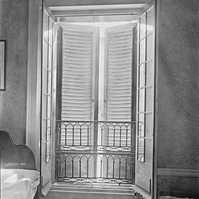 window with storm shutters open to the interior