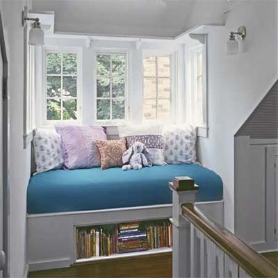 build a wall-to-wall window seat on the stair landing