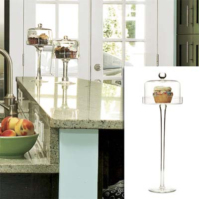 Glass pastry stand inset in image of remodeled bungalow kitchen
