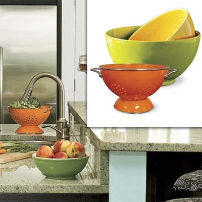 colorful earthenware nesting bowls and an enameled stainless-steel colander inset in image of remodeled bungalow kitchen