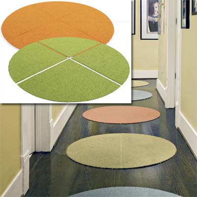examples of carpet-tile circle rugs inset in the image of the decorated hallway of this remodeled bungalow kitchen
