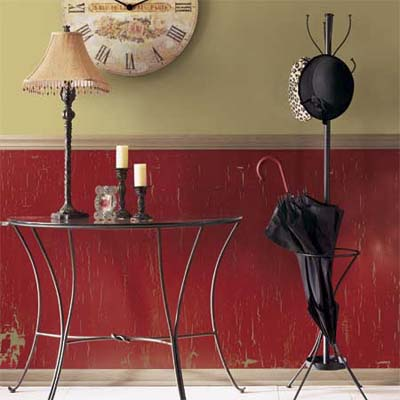 example of crackle painting technique with red wall below chair runner 