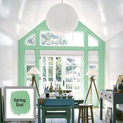 large arched window highlighted with the use of bright accent color