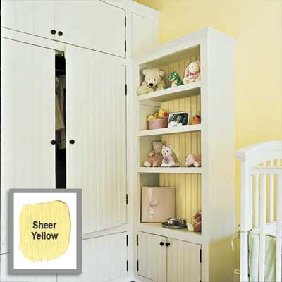 color on the back panel of this shelving unit helps give a light airy look to the whole unit