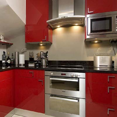 kitchen cabinets fronted by high-gloss, solid surface material doors