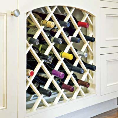 built in wine storage below the counter in this remodeled kitchen
