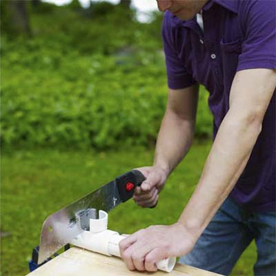 handsaw cutting pvc pipe pipe
