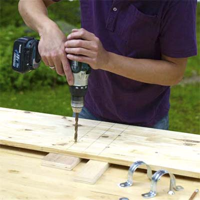 drilling the holes in the teeter-totter
