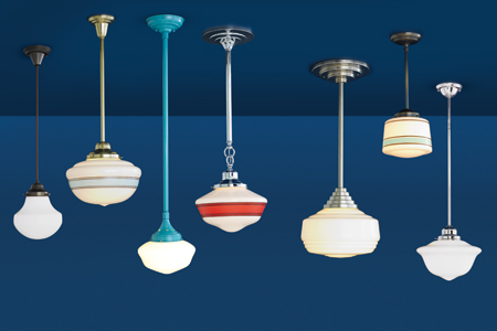7 schoolhouse pendant lights hanging in an undefined blue room