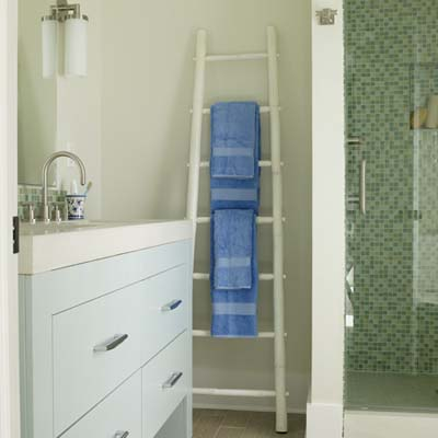 bathroom with ladder as used as a towel rack against the far wall