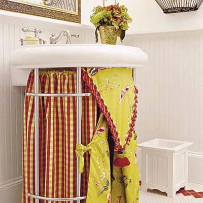 brightly colored skirt around a bathroom pedestal sink