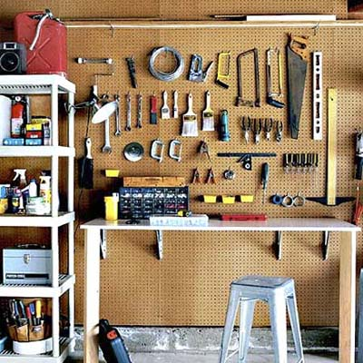 peg board used for tool storage at a workbench
