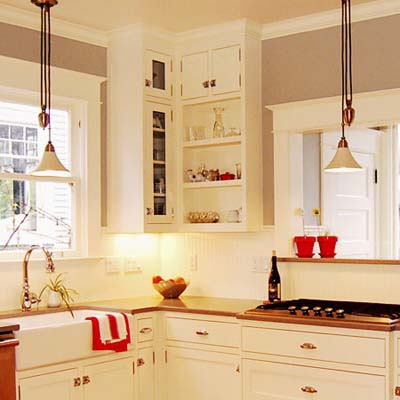 kitchen illustrating corner mounted open faced cabinets as shelving