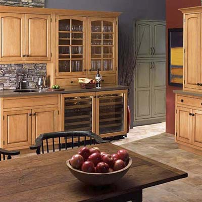 beautiful kitchen with crowned cabinets with a custom woodwork look