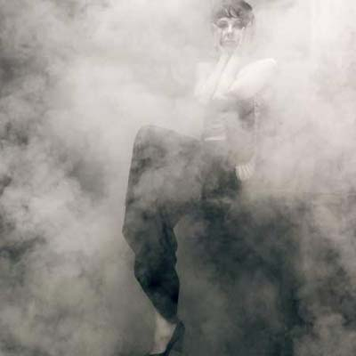 woman sitting in smoky room