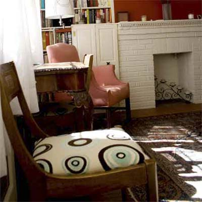 re-upholstering a chair can help tie colors and patterns of a room together
