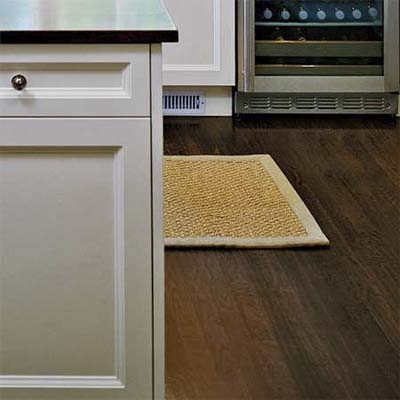 hardwood floors offer a handsome contrast to a mostly white kitchen