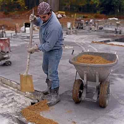 man shoveling dirt