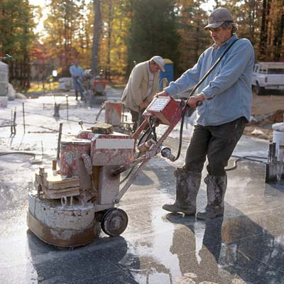 man grinding surface of the floor
