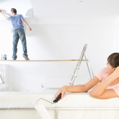 woman watching contractor paint