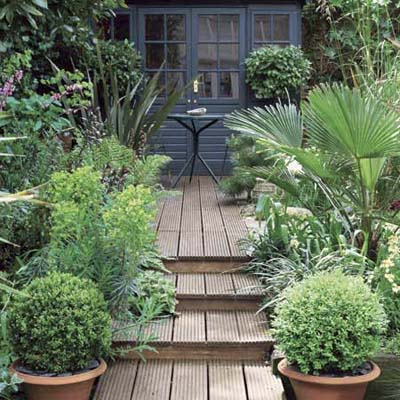 composite decking surrounded by lush plant life