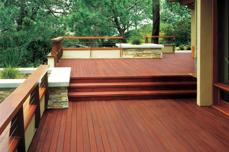 Large deck with burgundy-tinted stain