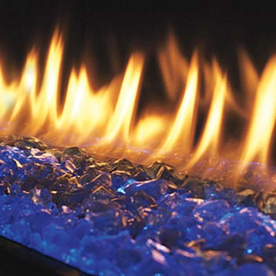 a gas fireplace bed made of colored glass chips