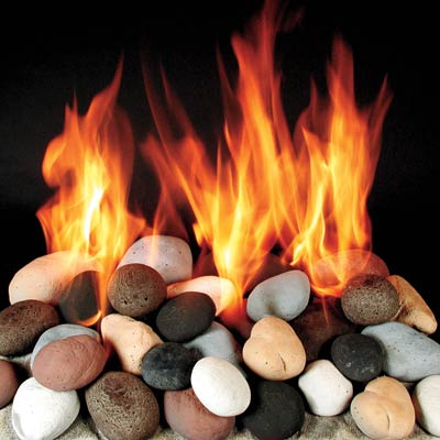 a gas fireplace bed made of ceramic made to look like calico-colored stones