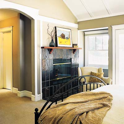 a gas fireplace in the bedroom