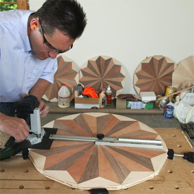 flooring craftsman, Charles Peterson assembling a wooden floor medallion