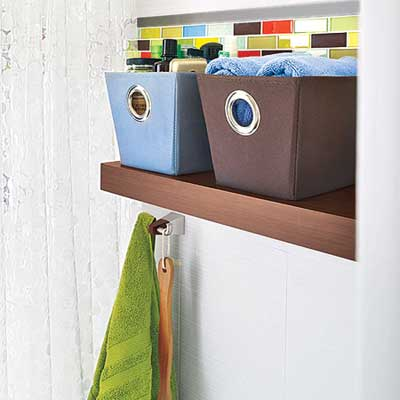 shower shelf cubby with baskets and a hook for towels