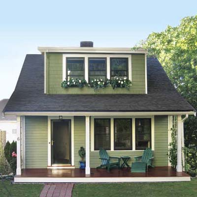 exterior house windows with green house white trim