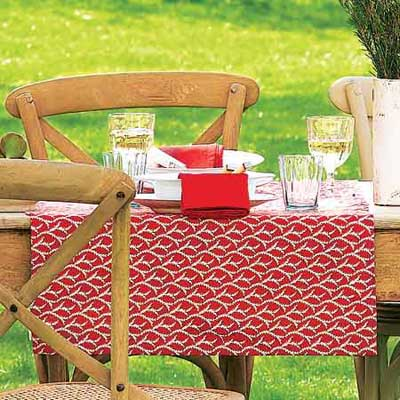outdoor dining table with colorful runners