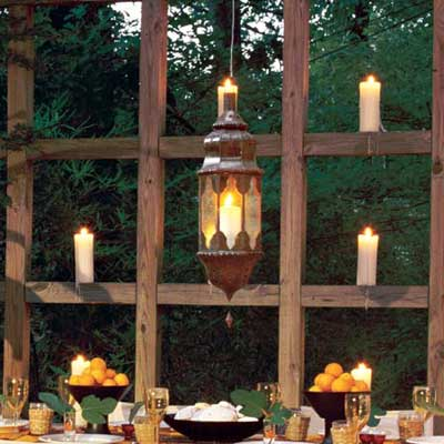 dining table on deck with grid candle wall