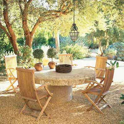 outdoor table under large shade tree