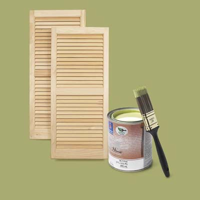 white-pine exterior shutters and a can of green exterior latex paint and brush