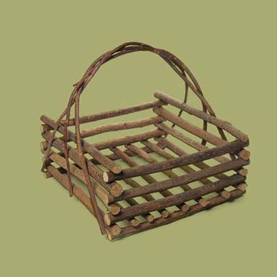 a storage basket for the porch made from stacked willow twigs