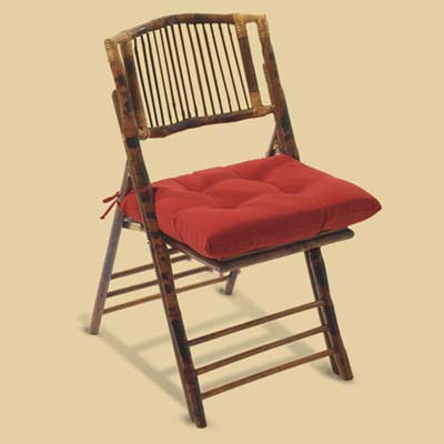 a bamboo folding chair made by Ballard Designs with a seat cushion by Improvements