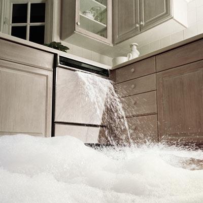 dishwasher overflowing water onto kitchen floor