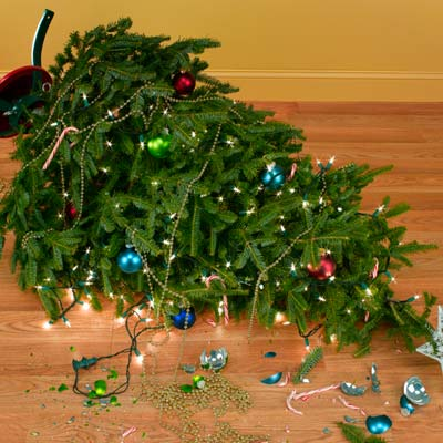 fallen christmas tree with broken ornaments
