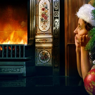 girl watching fireplace on christmas