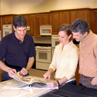 couple looking at catalog with contractor