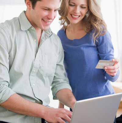 couple buying housewares online with credit card