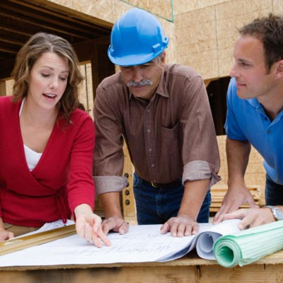 couple looking at plans with contractor